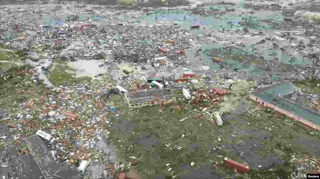 An aerial view of devastation after hurricane Dorian hit the Abaco Islands in the Bahamas, Sept. 3, 2019, in this still image from video obtained via social media.
