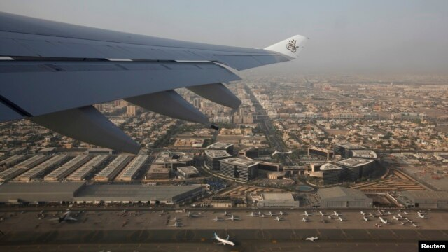 Logo of Emirates airline on the wing of one of its airplanes after takeoff from Dubai airport, United Arab Emirates, April 16, 2013.