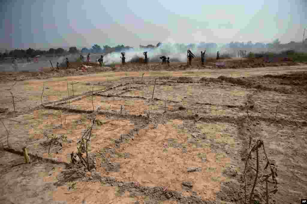 Newly-cleared plots of land are marked for settlement inside a makeshift camp at Mpoko Airport in Bangui, Jan. 7, 2014.