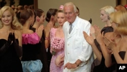 "French designer Hubert de Givenchy, seen in this July 1995 photo, is applauded by his models after his 1995-96 fall-winter haute couture fashion collection in Paris. French couturier Hubert de Givenchy, a pioneer of ready-to-wear who designed Audrey Hepburn's little black dress in ""Breakfast at Tiffany's,"" has died at the age of 91."