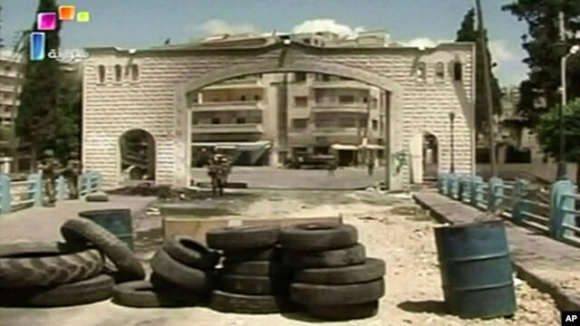 An image taken from video footage broadcast by the Syrian state television on June 14, 2011 shows Syrian troops deployed in the flashpoint town of Jisr al-Shughour