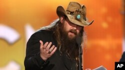 """Chris Stapleton accepts the award for album of the year for """"Traveller"""" at the 51st annual Academy of Country Music Awards in Las Vegas, April 3, 2016."""