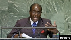 FILE: Zimbabwe's President Robert Mugabe addresses the 67th session of the United Nations General Assembly at UN headquarters in New York, September 26, 2012.