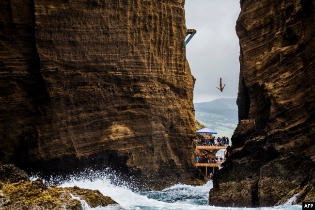This 2015 photo shows Jonathan Paredes of Mexico diving from the 27 meters in the Red Bull Cliff Diving World Series at Islet Franco do Campo, Azores, Portugal.