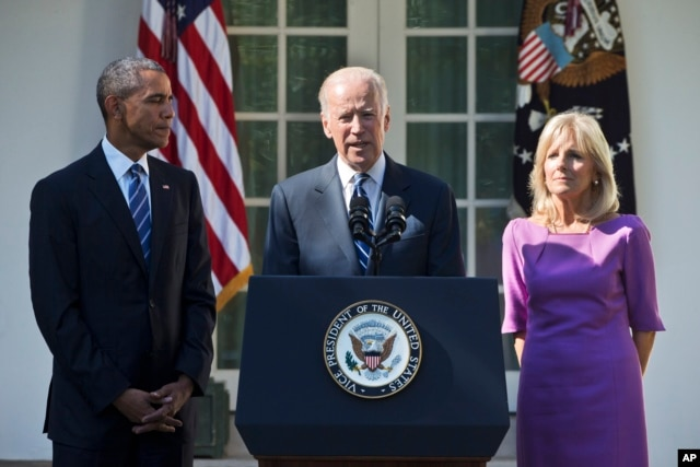 FILE - Vice President Joe Biden, accompanied by his wife Jill and President Barack Obama, announces that he will not run for the presidential nomination, Oct. 21, 2015, in the Rose Garden of the White House in Washington.