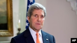 U.S. Secretary of State John Kerry, talking to reporters in London, says that without its revenue, the Palestinian Authority might stop security cooperation with Israel or even disband, Feb. 21, 2015.