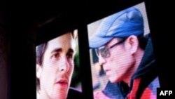 推销张艺谋执导影片《金陵十三钗》的视频显示张艺谋(右)和好莱坞影星克里斯汀·贝尔。(2012年12月22日)