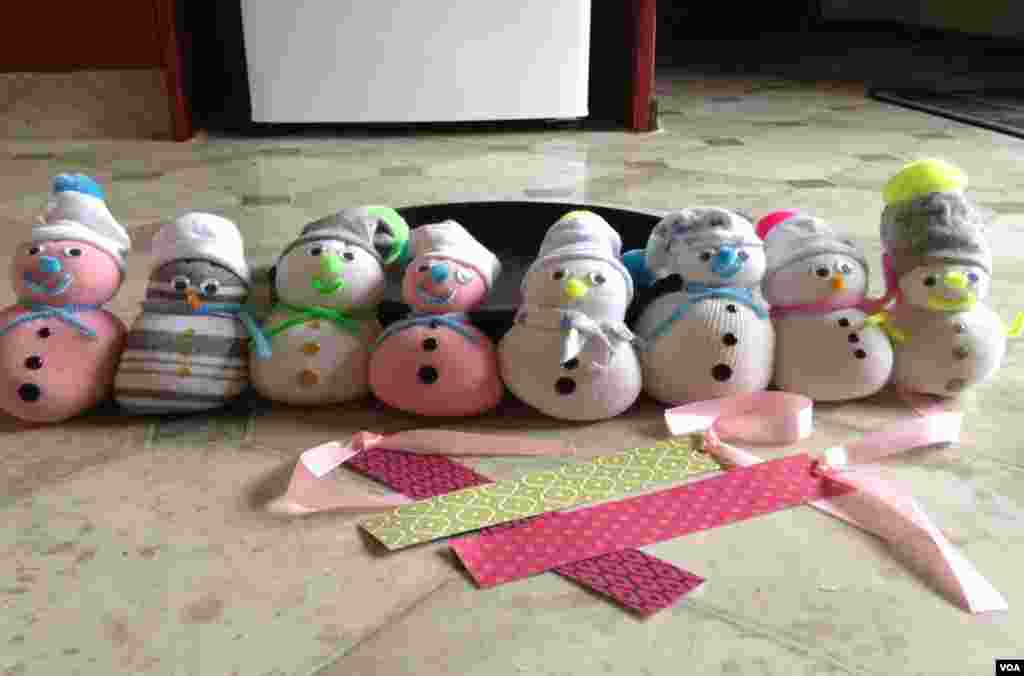 These snowman made by twin sister Shavali and Sheffali are selling for $10 each. They are part of fundraising activities for the Zimbabwe Rural School Library Trust meant to capacitate poor rural libraries.
