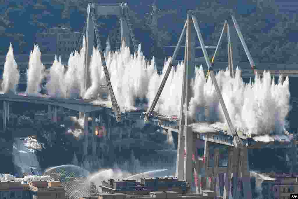 Explosive charges blow up the eastern pylons of Genoa's Morandi motorway bridge in Genoa, Italy.