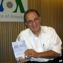 James Zogby with a copy of his new book, 'Arab Voices.'