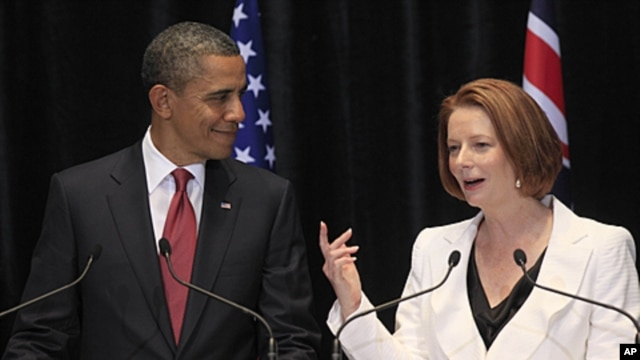 US President Barack Obama listens to Australian Prime Minister Julia Gillard during a joint press conference in Canberra, Australia, November 16, 2011.