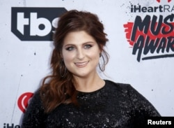 Singer Meghan Trainor poses at the 2016 iHeartRadio Music Awards in Inglewood, California, April 3, 2016.
