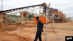 FILE - A security employee guards a diamond-processing plant in the diamond-rich eastern Marange region of Zimbabwe, Dec. 14, 2011