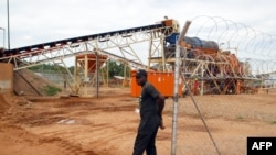 FILE - A security employee guards a diamond-processing plant in the diamond-rich eastern Marange region of Zimbabwe, Dec. 14, 2011