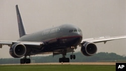 FILE--The first commercial flight by a Boeing 777 arrives at Dulles Airport in Dulles, Virginia, June 1995.