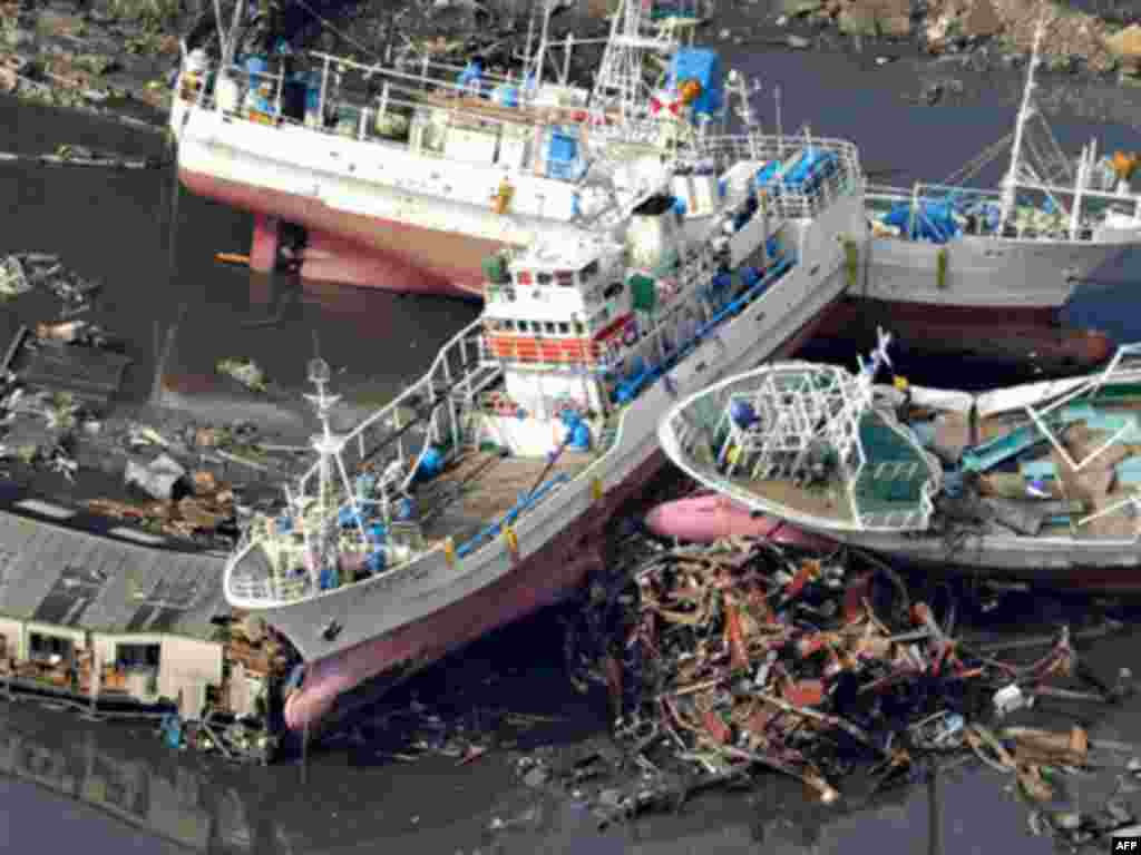 Vessels get stranded in Kesennuma, Miyagi prefecture, northern Japan, Saturday, March 12, 2011, after being washed away by an earthquake-triggered tsunami.