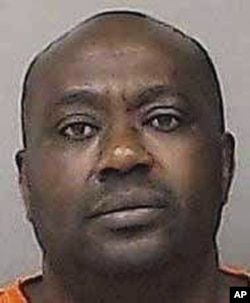 This undated photo provided by the Linn County Jail in Cedar Rapids, Iowa, shows Gervais Ngombwa. A federal judge sentenced Ngombwa March 2, 2017, for lying to gain citizenship in the U.S. after helping carry out deadly attacks during the country's 1994 genocide.