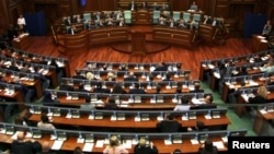 Members of the Kosovo Parliament are seen during a discussion where they rejected a constitutional amendment allowing the creation of a special European Union-backed court, in Kosovo, June 26, 2015.