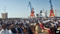 Participants listen to speeches during the opening ceremony of newly built Gwadar port, about 700 kilometers (435 miles) west of Karachi, Pakistan (File Photo - March 20, 2007)