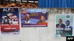Picture in Monrovia shows campaign posters on a wall as the campaign kicks off for the presidency and House of Representatives elections in October.