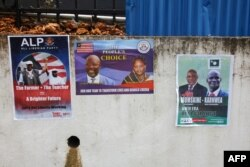 FILE - Picture taken July 31, 2017 in Monrovia shows campaign posters on a wall as the campaign kicks off for the presidency and House of Representatives elections in October.