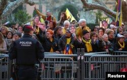FILE - Pro-independence demonstrators shout during a protest outside the regional parliament in Barcelona, Spain, Jan. 30, 2018.