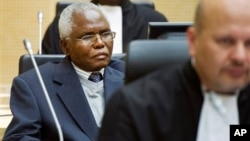 Cabinet Secretary Francis Muthaura, left, in the courtroom of the International Criminal Court, The Hague, Netherlands, Sept. 21, 2011.