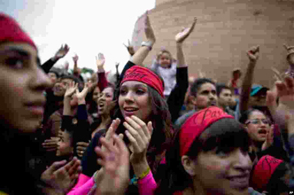 People enjoy at the Pa' bailar event, the closure night of the Innovate Tijuana festival in Tijuana, Mexico, Thursday, Oct. 21, 2010. (AP Photo/Guillermo Arias)