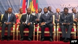 (L-R) Presidents Mahamadou Issoufou of Niger, Ali Bongo Ondimba of Gabon, Faure Gnassingbe of Togo and Idriss Deby Itno of Chad attend the opening in Yaounde of a meeting on maritime security in the Gulf of Guinea, June 24, 2013.