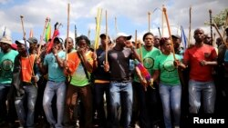 Mine workers gather at Wonderkop stadium outside the Lonmin mine in Rustenburg, northwest of Johannesburg, Jan. 29, 2014.