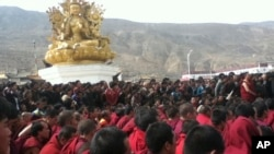 FILE - Tibetan monks gather March 14, 2012.