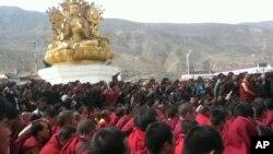 FILE - Tibetan monks gather March 14, 2012.