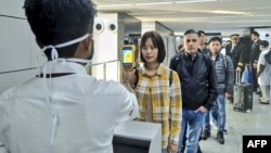 Du khách bị sàng lọc nghiêm ngặt tại phi trường quốc tế Nataji Subhash Chandra Bose, Ấn Độ, vào ngày 21/1/2020, đặc biệt là du khách đến từ Trung Quốc, Hong Kong.