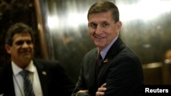 FILE - Retired U.S. Army Lieutenant General Michael Flynn stands by the elevators as he arrives at Trump Tower where U.S. President-elect Donald Trump lives in New York.