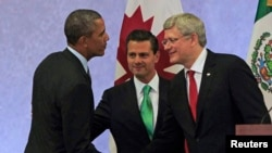 U.S. President Barack Obama (L) shakes hands with Canada's Prime Minister Stephen Harper (R) as Mexico's President Enrique Pena Nieto looks on after attending a news conference, at the North American Leaders' Summit in Toluca near Mexico City, Feb. 19, 20