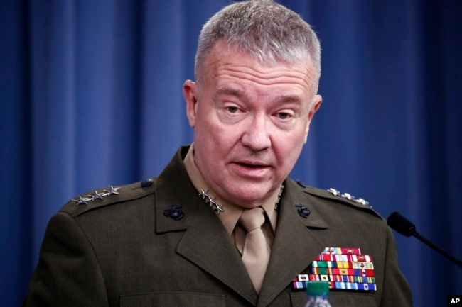 "FILE - In this April 14, 2018, photo, then-Marine Lt. Gen. Kenneth ""Frank"" McKenzie Jr. speaks during a media availability at the Pentagon in Washington. McKenzie, now the top commander of U.S. forces in the Mideast, says Iran appears to have decided to ""step back and recalculate"" in response to a U.S. military buildup in the Persian Gulf area."
