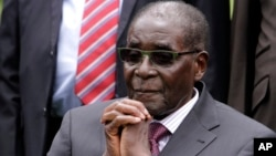 File - Zimbabwe President Robert Mugabe listens after a swearing-in ceremony at the State House in Harare, Zimbabwe.