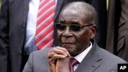 FILE - Zimbabwean President Robert Mugabe began his one-year term as chairman of the African Union at the start of the summit Friday.