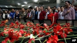 Family members, colleagues and friends of the victims of Tuesday's blasts gather for a memorial ceremony at the Ataturk airport in Istanbul, June 30, 2016.