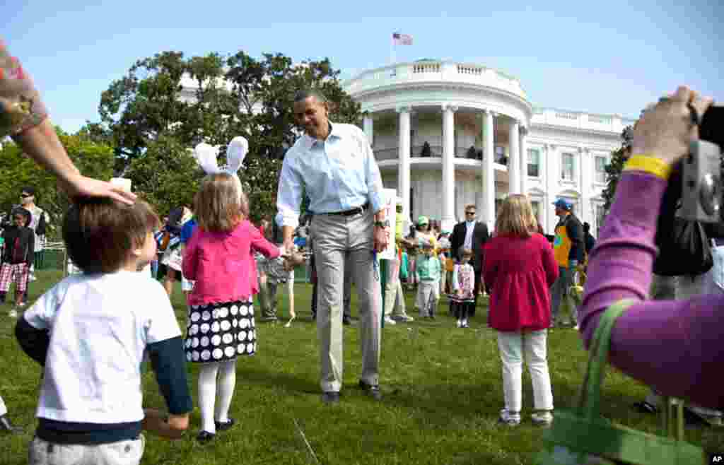 President Barack Obama attends the opening of the annual Easter Egg Roll festivities at the White House in Washington, April 9, 2012. (AP)