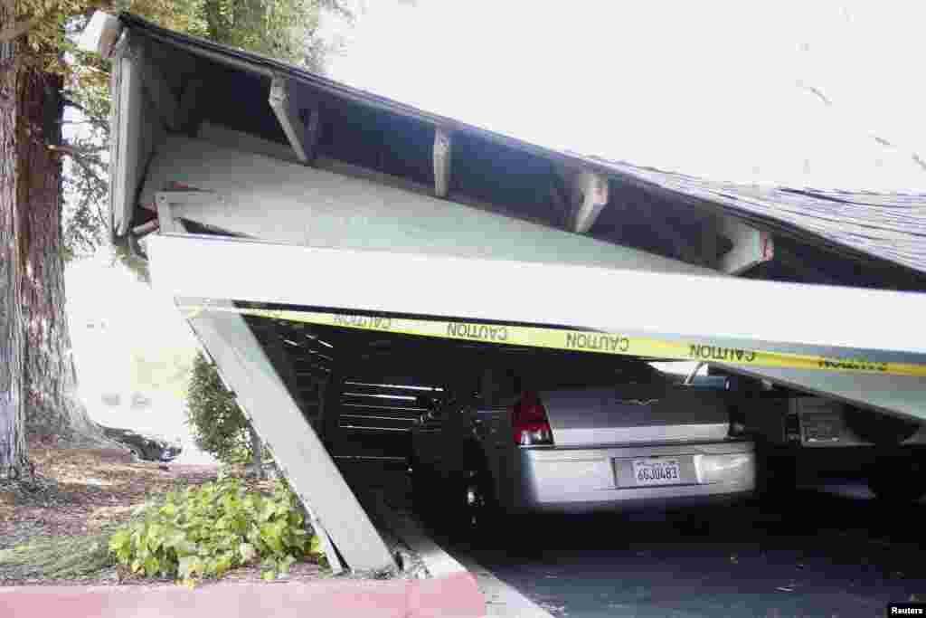 A vehicle is trapped beneath a collapsed parking structure in Napa, California, Aug. 24, 2014.