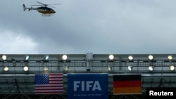 A police helicopter flies over the roof of the Arena Pernambuco before the German national soccer team start their training session in Recife, June 25, 2014.