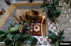 A man sits inside a moorish house in the old city of Algiers Al Casbah, Algeria, Dec. 3, 2015.
