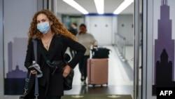 Putnici na aerodromu u Čikagu (Foto: KAMIL KRZACZYNSKI / AFP)
