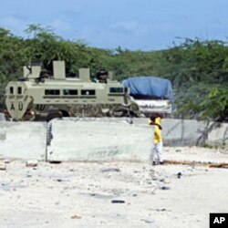 An African Union armored personnel carrier enters the heavily-fortified AMISOM headquarters in Mogadishu