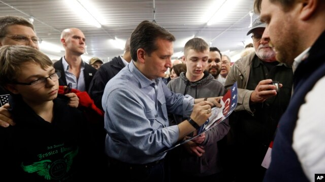Republican presidential candidate, Sen. Ted Cruz, autographs a sign during a campaign event at the Johnson County Fairgrounds, Jan. 31, 2016 in Iowa City, Iowa.
