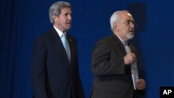 FILE - U.S. Secretary of State John Kerry, left, and Iranian Foreign Minister Javad Zarif arrive at the Swiss Federal Institute of Technology, or Ecole Polytechnique Federale De Lausanne, in Lausanne, Switzerland, April 2015.