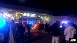 This image from video provided by KSTP 5 television in Minneapolis, Minnesota, shows people standing outside the scene of a stabbing at the Crossroads Center mall in St. Cloud, Minnesota.