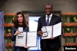 The Peace Prize laureates Iraqi Nadia Murad and Congolese doctor Denis Mukwege receive the Nobel Peace Prize for their efforts to end the use of sexual violence as a weapon of war and armed conflict at the Nobel Peace Prize Ceremony in Oslo Town Hall in Oslo, Norway, Dec. 10, 2018.