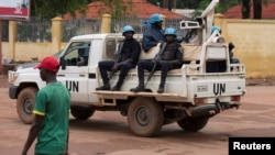 FILE - United Nations peacekeepers ride a pickup truck while on patrol in Bangui, Central African Republic, April 24, 2017.